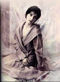 Enya: Fashion shoot photo, heavy drapy gown, seated on floor